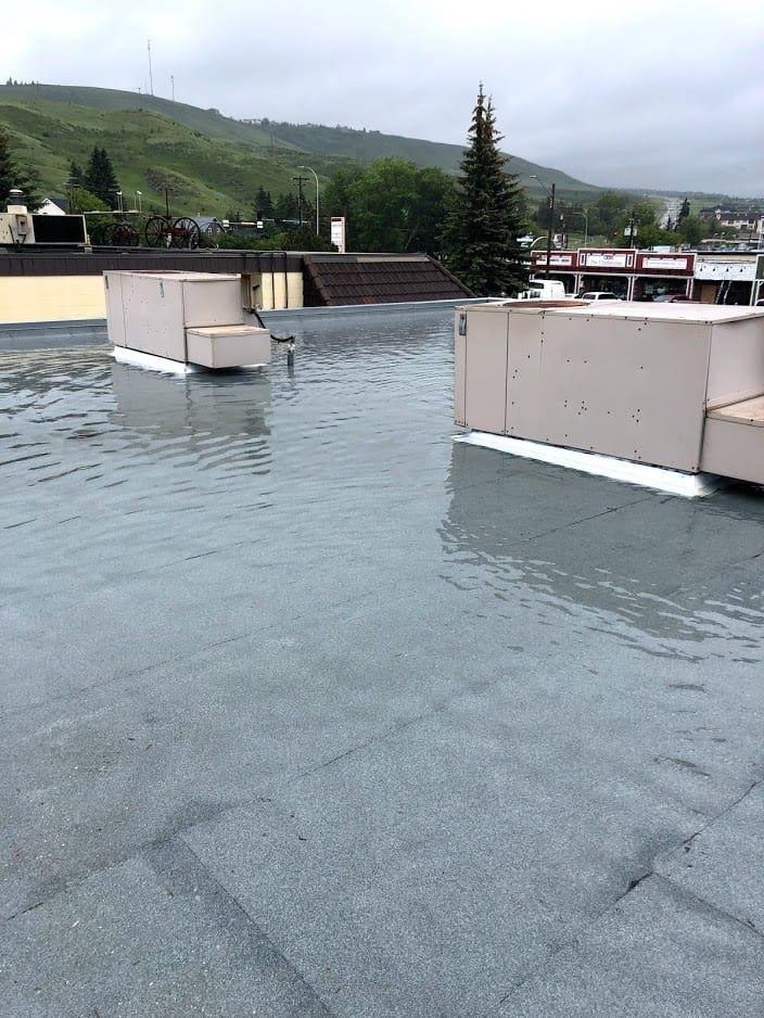 Roof in chocrane that flooded from improper drainage